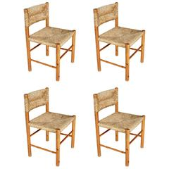 Set of Four Rush Chairs by Charlotte Perriand