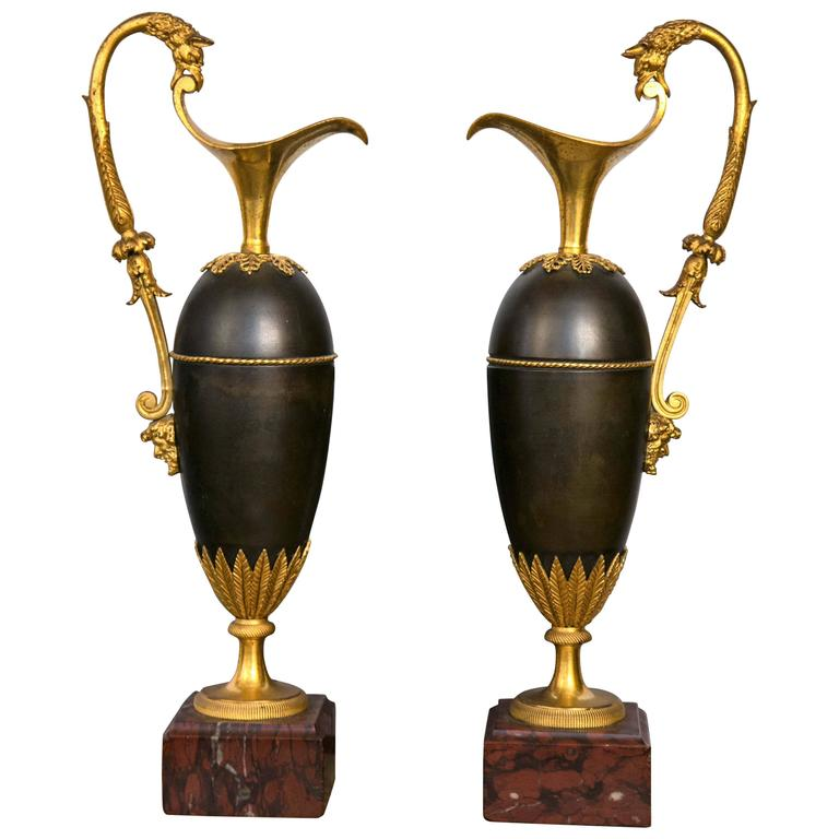 Pair of Period Empire Patinated and Gilt Bronze Ewers