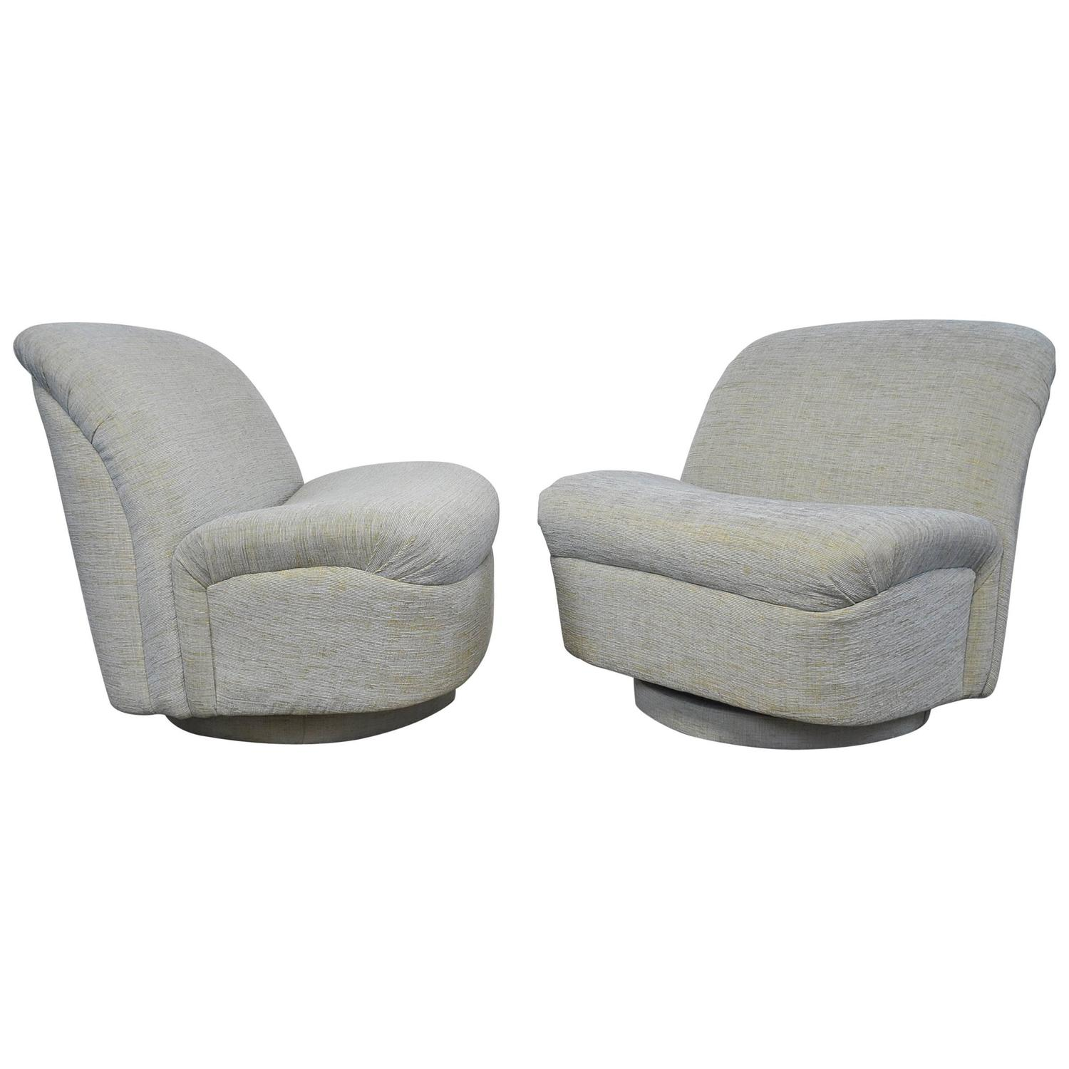 pair of 1980 s reclining swivel white leather lounge chairs for