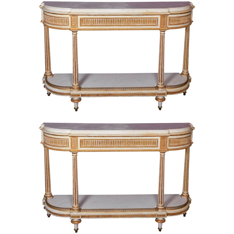 Pair of Louis XVI Parcel-Gilt and White Painted Ormolu-Mounted Console Tables