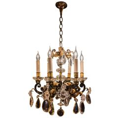 French Iron and Crystal Chandelier Attributed to Maison Baguès, circa 1940