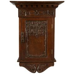 Arts and Crafts Carved Oak Wall Cabinet