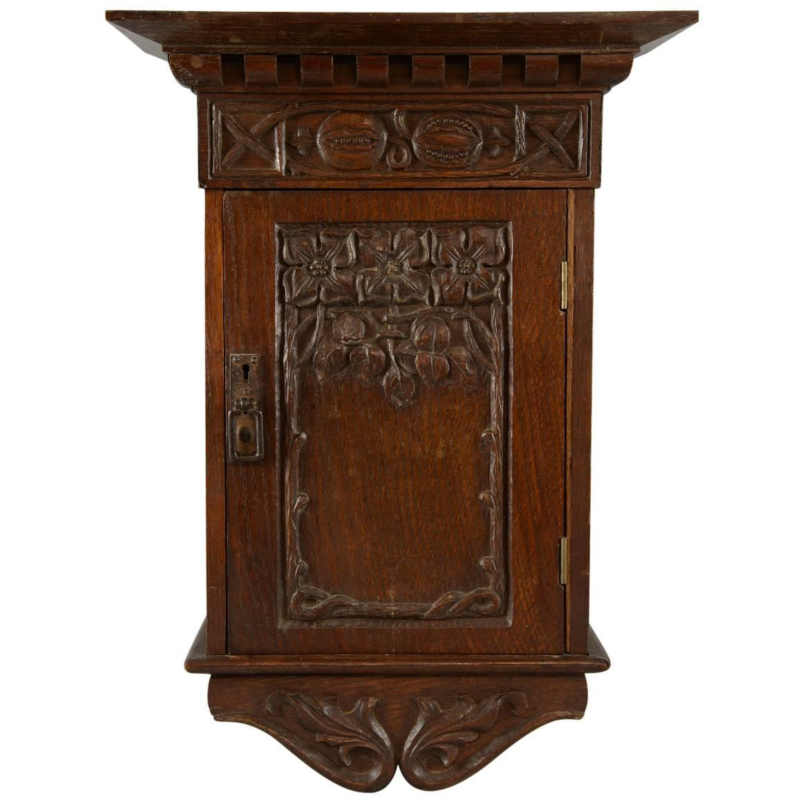 Arts and crafts carved oak wall cabinet for sale at 1stdibs for Arts and crafts storage cabinet