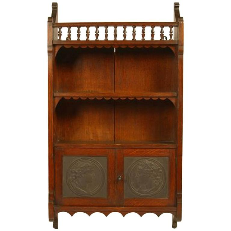 E W Godwin Attr An Anglo Japanese Oak Wall Cabinet With Embossed Leather  Panels For Sale