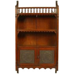 E W Godwin Attr An Anglo-Japanese Oak Wall Cabinet with embossed Leather Panels