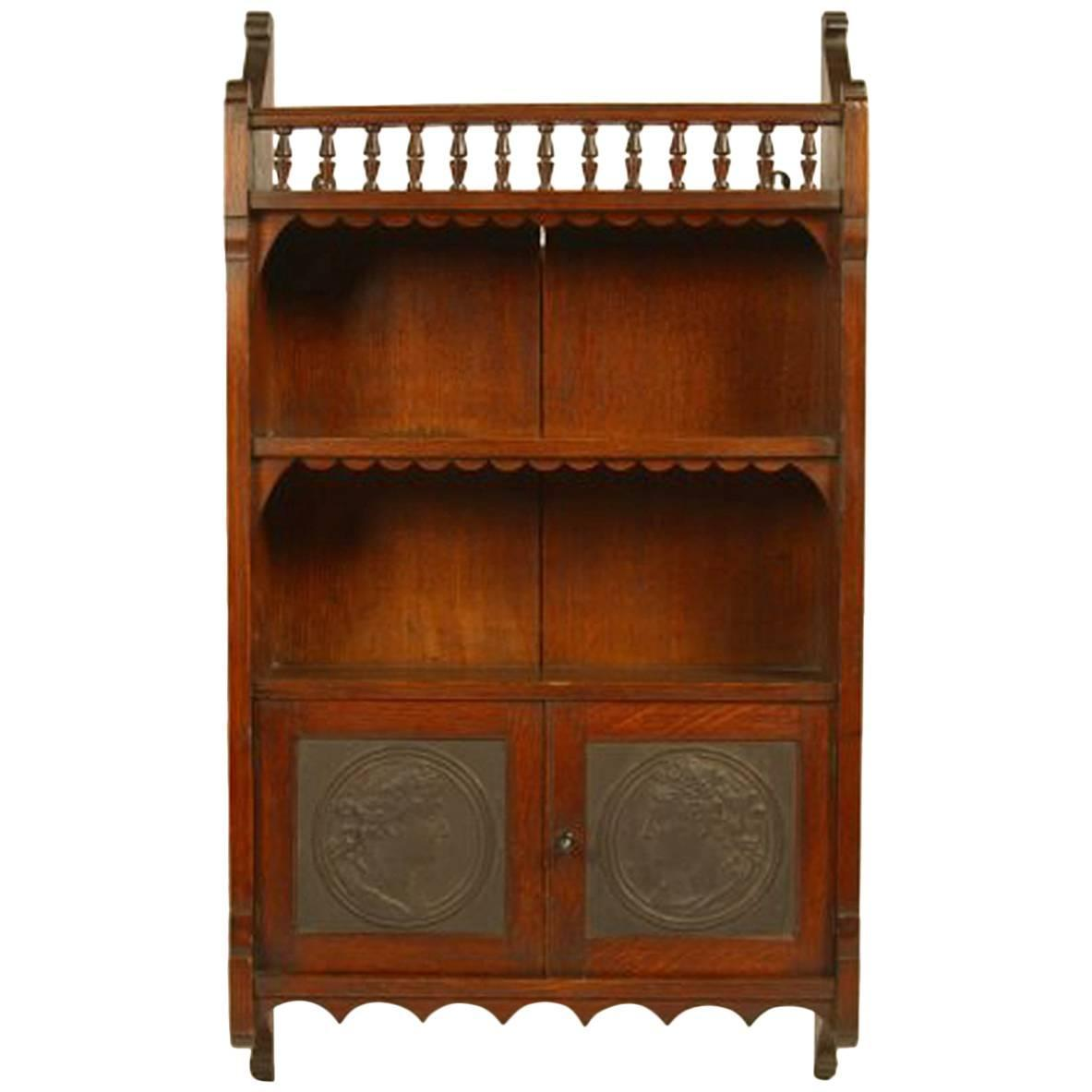 Arts and crafts oak wall cabinet attributed to e w godwin for Arts and crafts storage cabinet