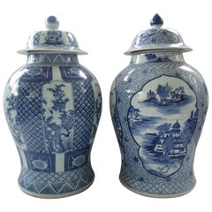Pair of Chinese Blue and White Jars with Lids