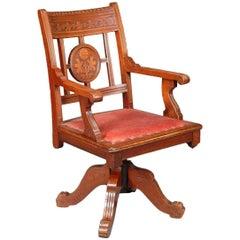 Charles Eastlake attri., Aesthetic Movement Walnut & Carved Swivel Desk Armchair