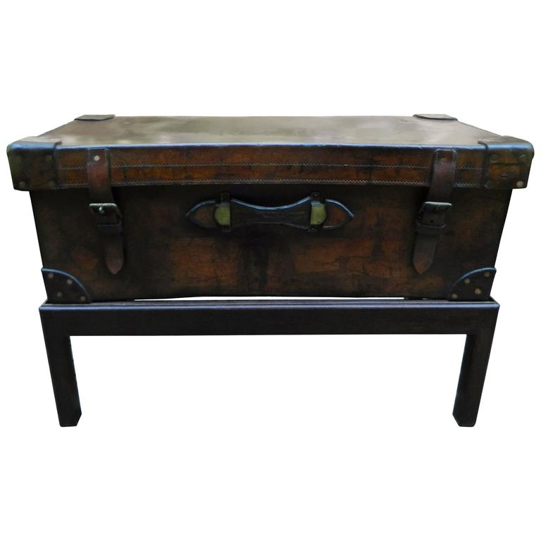 English Leather Trunk Adapted As A Coffee Table On A Wood