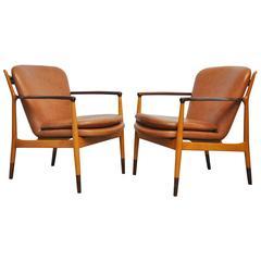 """Finn Juhl """"Delegate Lounge Chairs"""""""