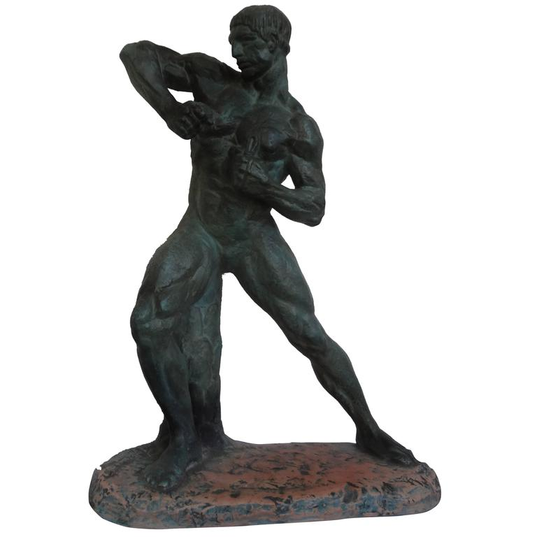 This fabulous French Art Deco patinated terracotta sculpture of a nude male athlete is signed Henri Bargas. This well executed sculpture has a patinated finish that resembles bronze and dates to the 1930s. The base of this composition was purposely