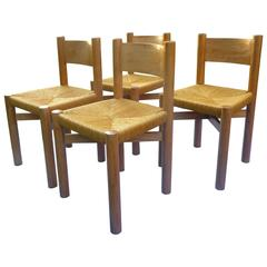 Set of Four Charlotte Perriand Oak Chairs for Méribel, circa 1950
