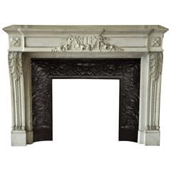 Louis XVI Style Fireplace in White Carrara Marble with Carved Garland of Flowers