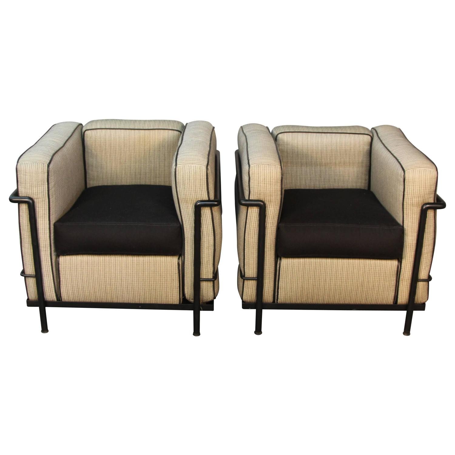 Pair of lc2 le corbusier chairs with black frames for sale at 1stdibs