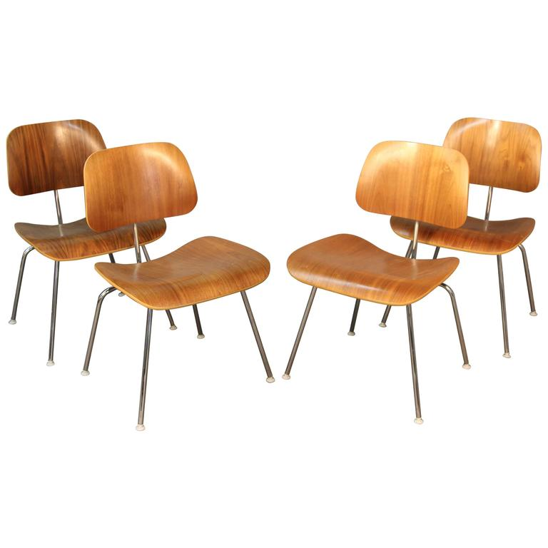 this set of four eames dcm chairs for herman miller is no longer