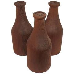 Group of Three Folky Wood Carnival Milk Bottles