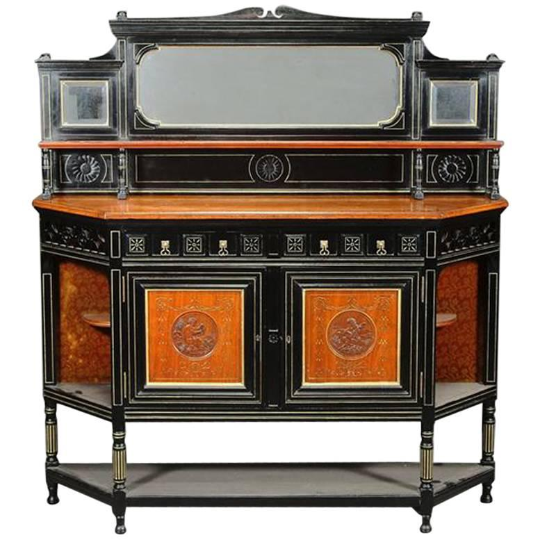 Bruce Talbert, attr An Ebonised Side Cabinet Carved with Putti playing the Lute
