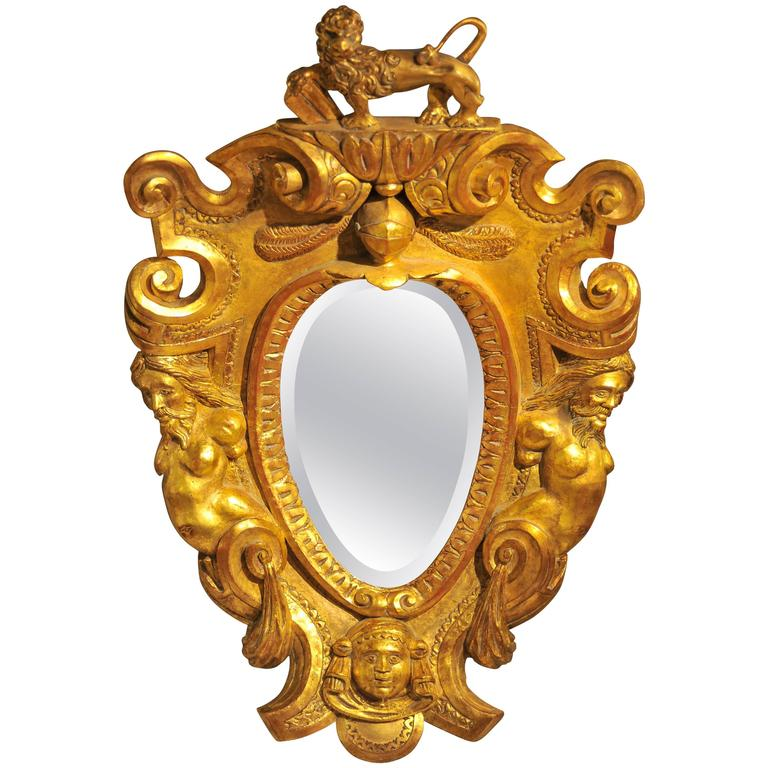 Late 17th Century Italian Carved and Gilt wood Frame with Curved Mirror Plate