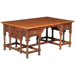 An Anglo-Moorish Walnut Partners' Desk, Attributed to Liberty and Co.