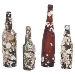 Set of Four Barnacle Encrusted Vintage Bottles, Priced Individually