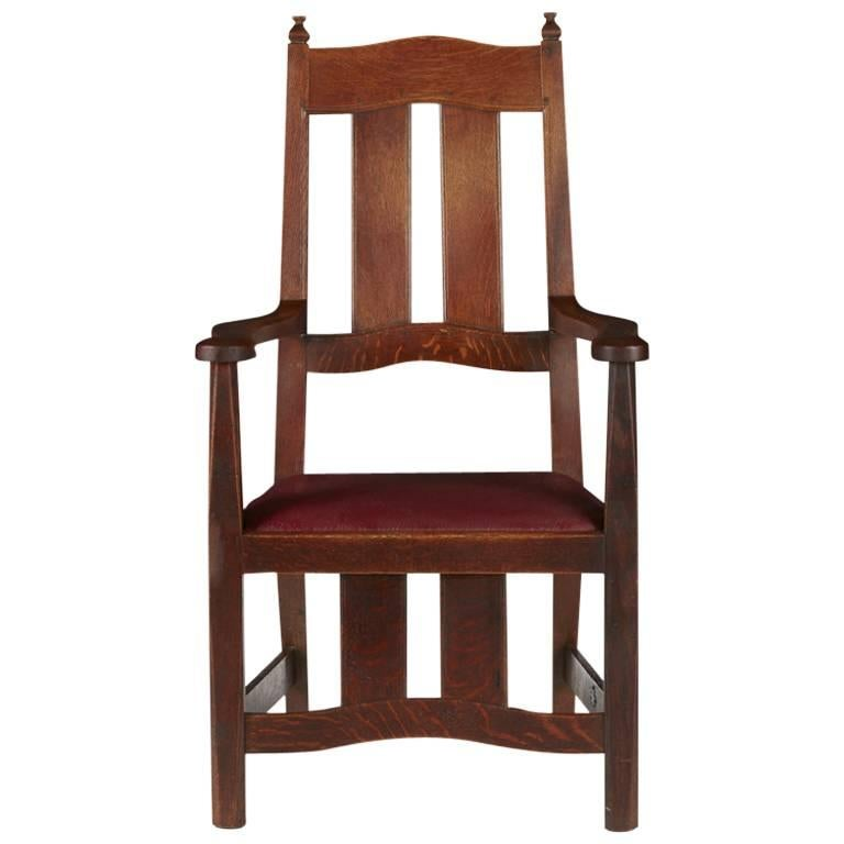 W R Lethaby. A Rare Arts & Crafts Sculptured Oak Armchair with Shaped Arms.