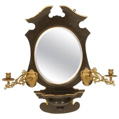 An Aesthetic Movement Ebonized and Gilt Mirror with Brass Candle Sconces