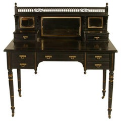 Ebonized and Parcel Gilt Aesthetic Movement desk by Maple and Co