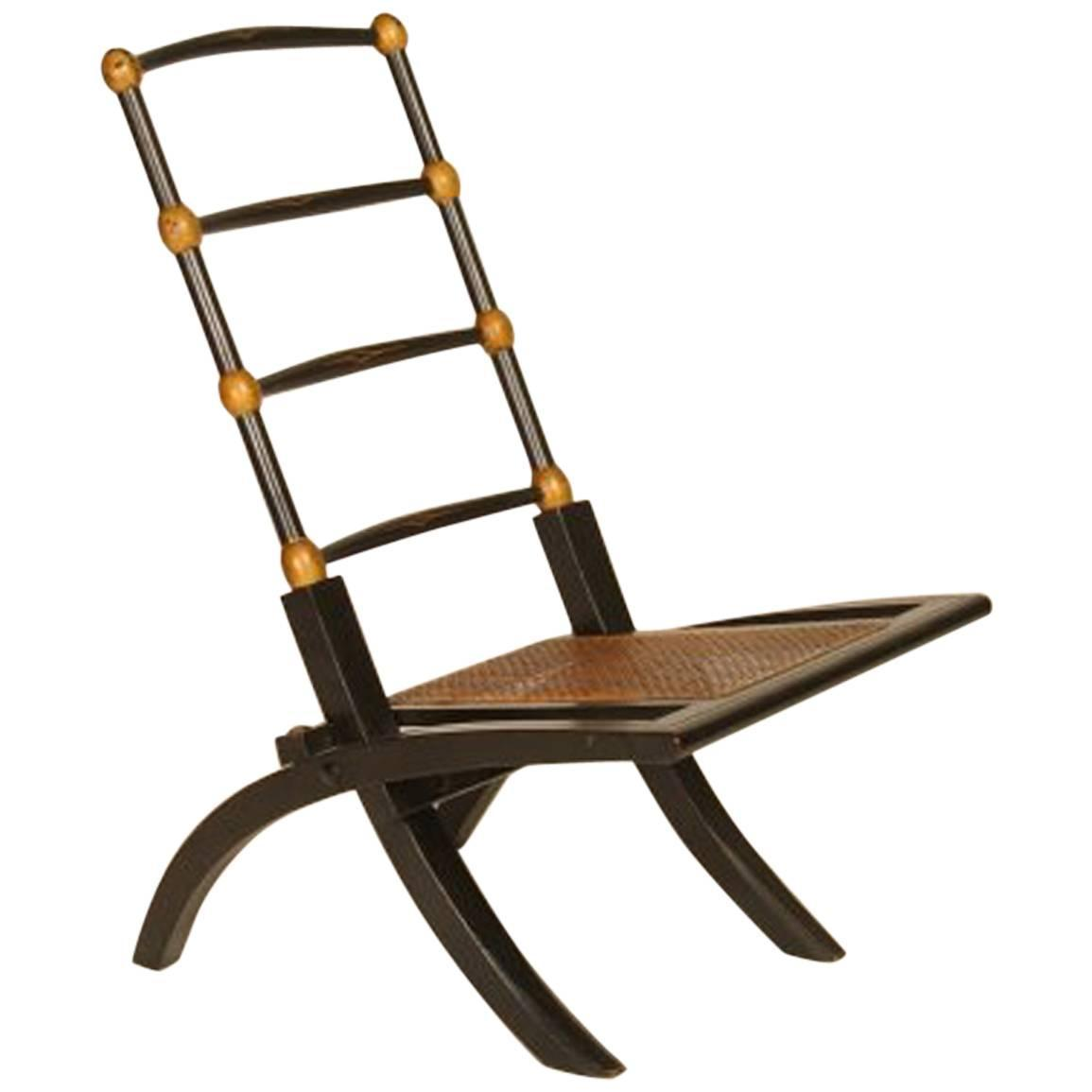 Ebonized Folding Chair with Cane Seat Attributed to E W Godwin For Sale at 1
