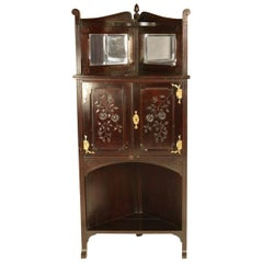 An Aesthetic Movement Mahogany Corner Cabinet with Incised Floral Decoration