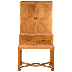 Charles Spooner Arts & Crafts Oak secretaire Cabinet with Serpentine Stretchers