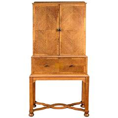 A rare Arts & Crafts Oak Cabinet with serpentine stretchers by Charles Spooner