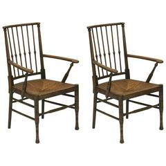 Two Liberty and Co Egyptian Style Thebes Rush Seated Armchairs