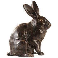A Japanese Patinated Bronze Sculpture of a Hare with Glass Eyes, Signed
