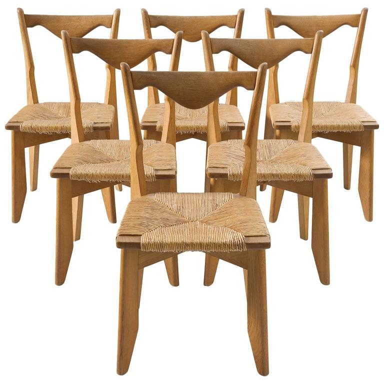 Guillerme & Chambron Set of Six Dining Chairs in Oak and Woven Seating For Sale