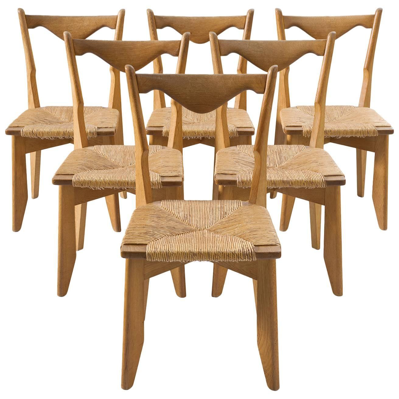 Of four chairs in oak and patinated cognac leather for sale at 1stdibs - Guillerme And Chambron Set Of Six Dining Chairs In Oak And Woven Seating For Sale At 1stdibs