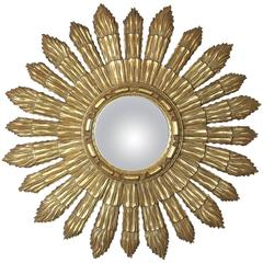 Carved and Gilt Decorated Sunburst Convex Mirror