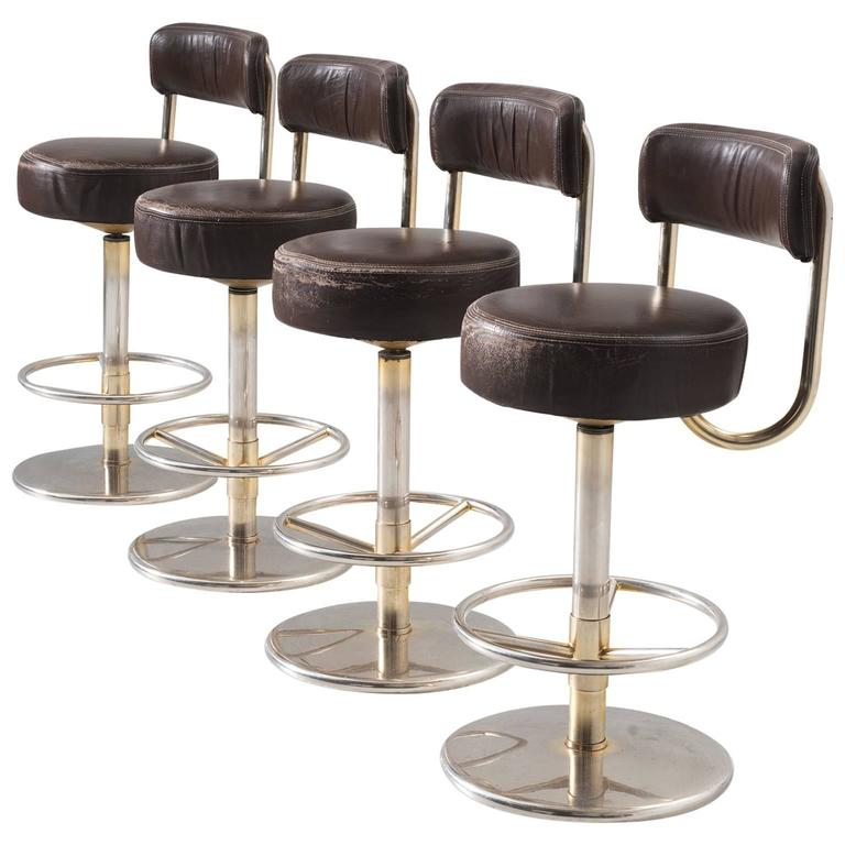 Set Of Four Bar Stools In Brass Colored Metal And Brown