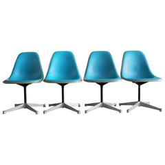 Four Herman Miller Upholstered Pedestal Chairs by Charles and Ray Eames