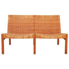 A mid-century design two-seat bench by Ejner Larsen & Aksel Bender Madsen