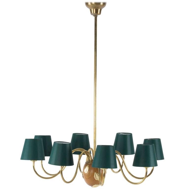 Brass and Mahogany Chandelier by Hans Bergström For Sale