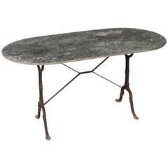 Antique French Weather Aged Marble-Top Cast Iron Garden Table or Bistro Table