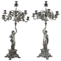 Pair of 19th Century Neoclassical Silvered Brass Eleven-Light Figural Candelabra
