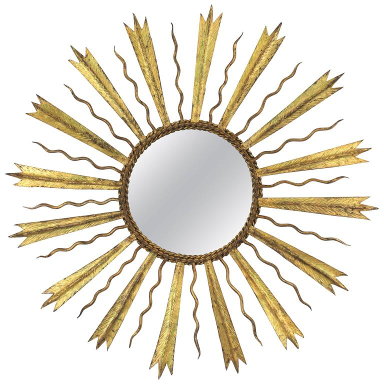 French Gilt Iron Sunburst Mirror in the Manner of Gilbert Poillerat For Sale