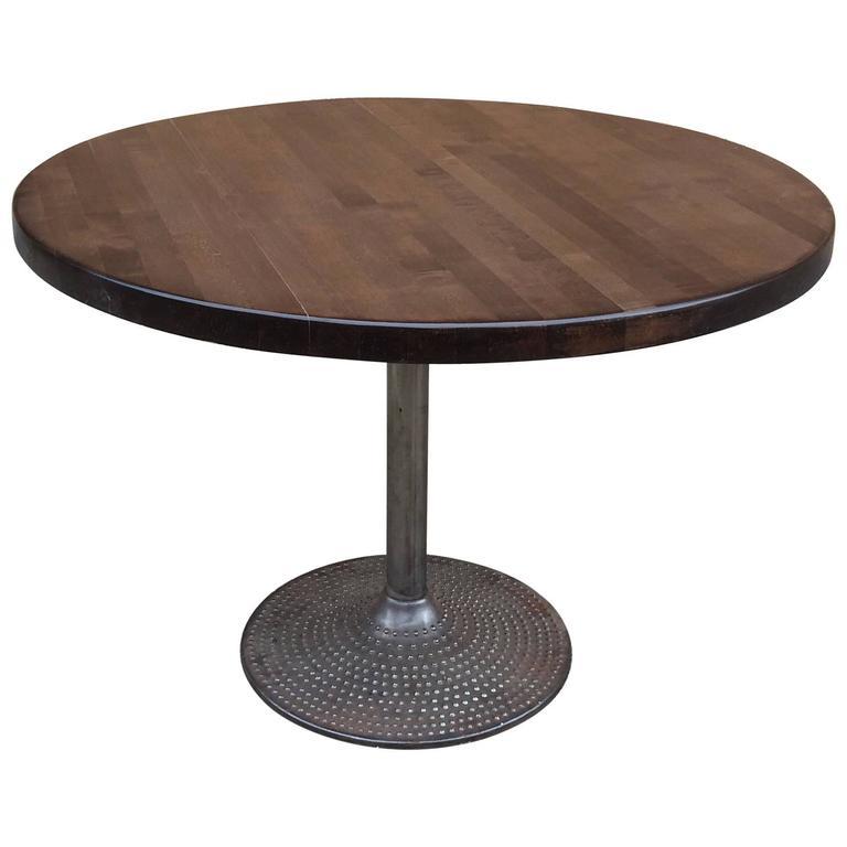 Round ebonized maple and cast iron industrial dining table for Cast iron dining table