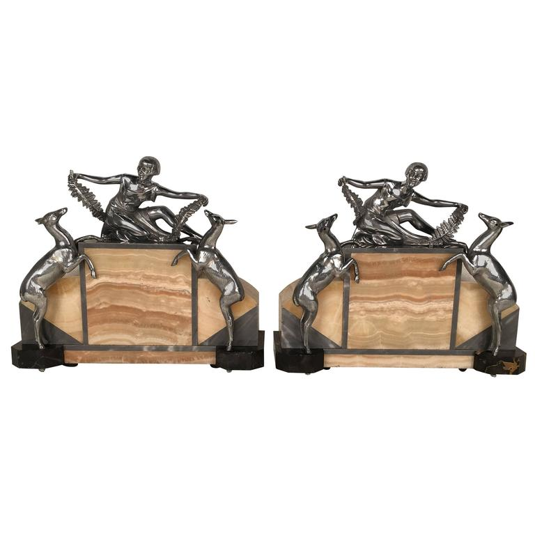 Pair of figural Art Deco Silverplated  and Onyx Lamps