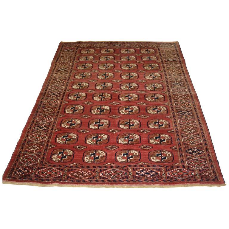 Old Tekke Turkmen Rug Of Traditional Design And Soft Red
