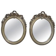 Pair of 19th Century Silver Gilded Oval Mirrors