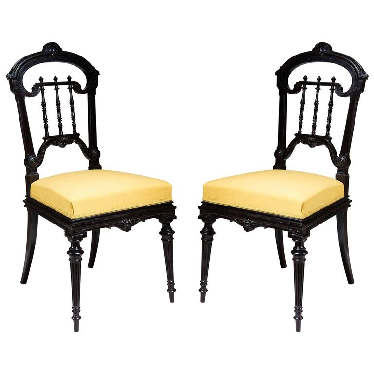 Pair of Solid Ebony Side Chairs For Sale