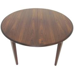 Danish Rosewood Dining Table with Three Leaves by Henning Kjaernulf