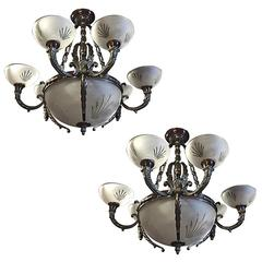 Pair of Nine-Light Crystal and Bronze Domed Chandelier Depicting Gargoyle
